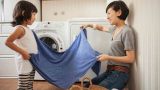 Best dryers 2021: A mother and daughter fold laundry after it has come out of the dryer