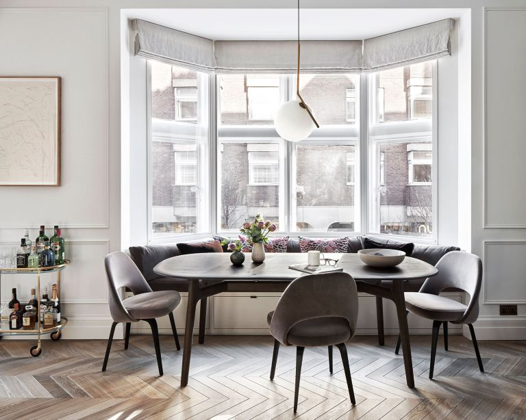 Window seat idea with dining table and armless chairs