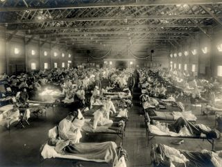 Beds with patients in an emergency hospital in Camp Funston, Kansas, in the midst of the Spanish flu pandemic.