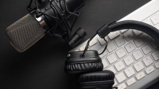 Best podcasting gear - a mic, headphones and computer keyboard are some of the items you'll need