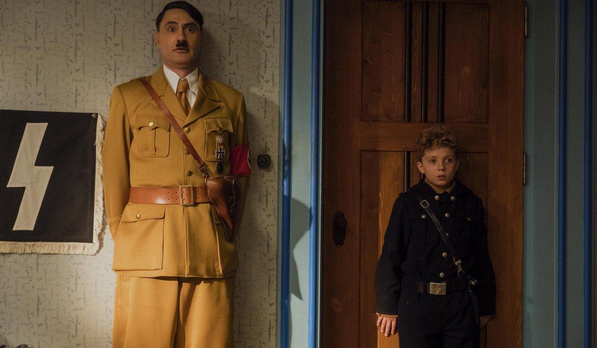 Jojo Rabbit Hitler and Jojo backs against the wall