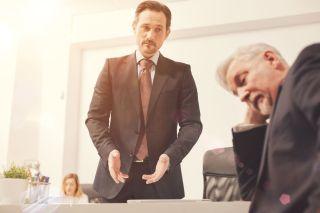Supervisor talke with sad employee feeling guilty