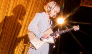 St. Vincent with her new Ernie Ball Music Man signature Goldie guitar