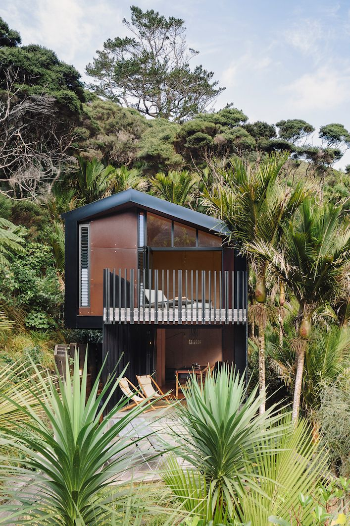 Inside a surfer's modern and minimalist beach-front cabin in New Zealand