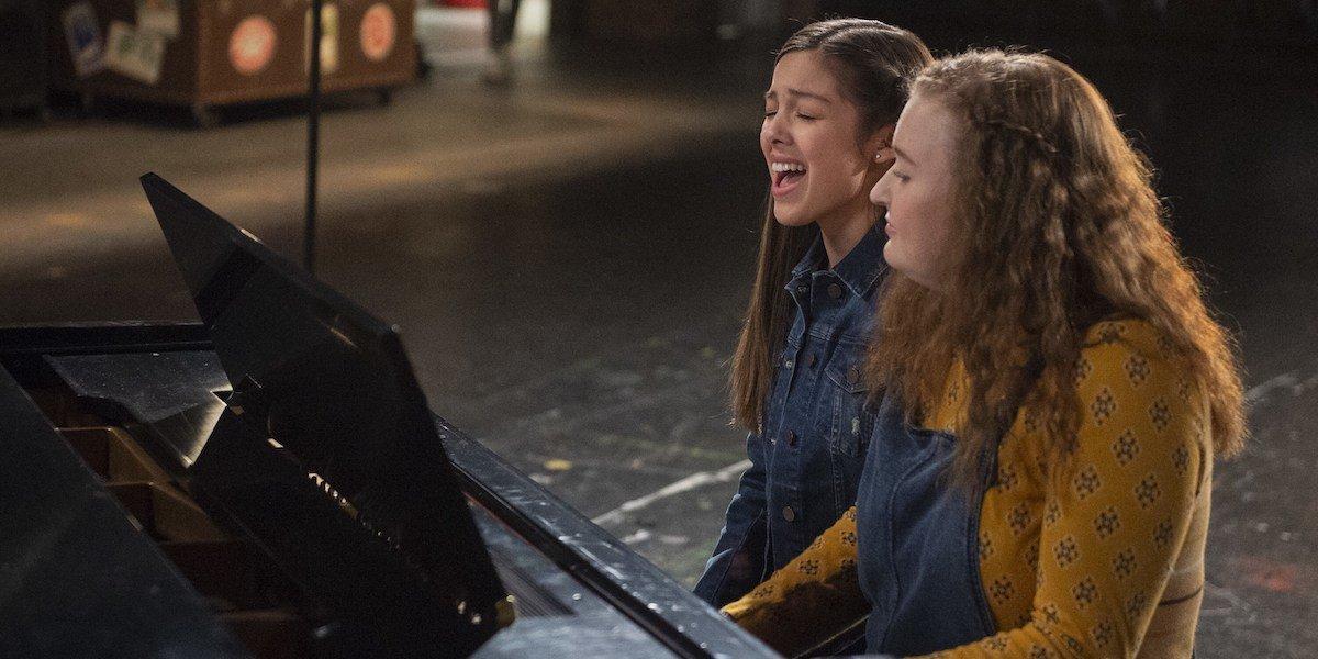 Olivia Rodrigo and Julia Lester singing Wondering at the piano in High School Musical series