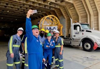"""NASA astronauts Barry """"Butch"""" Wilmore (left) and Mike Fincke take a selfie on June 21, 2021, with a United Launch Alliance Atlas V rocket and the crew of R/S RocketShip, the ship that hauled the launcher from Alabama to Florida's Space Coast. This Atlas V will launch Wilmore, Fincke and fellow NASA astronaut Nicole Mann on Crew Flight Test, Boeing's first crewed mission to the International Space Station for NASA, in late 2021."""