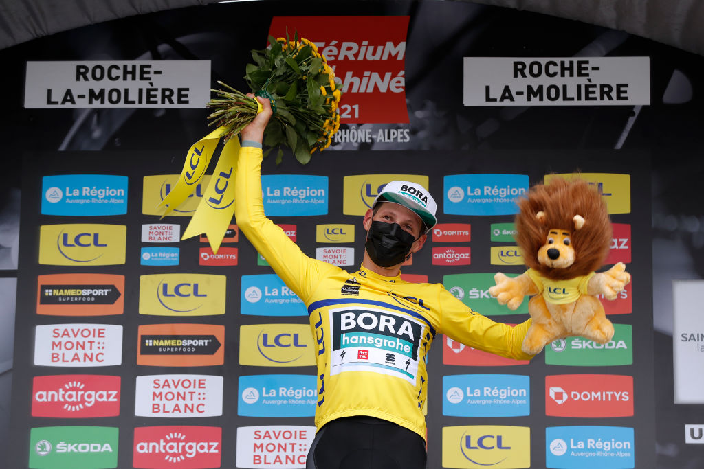 ROCHELAMOLIERE FRANCE JUNE 02 Lukas Pstlberger of Austria and Team Bora Hansgrohe Yellow Leader Jersey celebrates at podium during the 73rd Critrium du Dauphin 2021 Stage 4 a 164km Individual Time Trial stage from Firminy to RochelaMolire 585m Lion Mascot ITT UCIworldtour Dauphin dauphine on June 02 2021 in RochelaMoliere France Photo by Bas CzerwinskiGetty Images