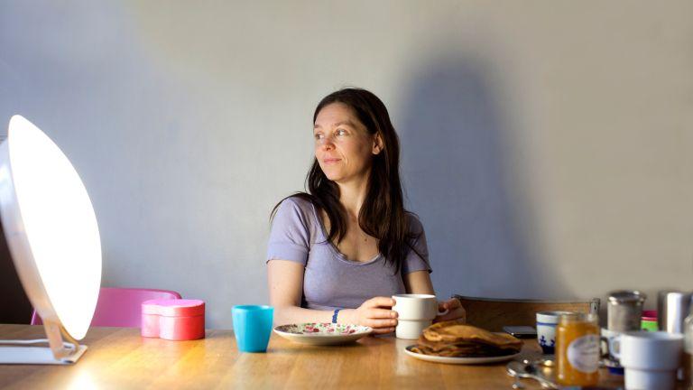 Woman looking at an SAD lamp