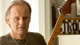portrait of Walter Trout with his guitar
