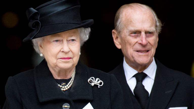 Britain's Queen Elizabeth II and Britain's Prince Philip, Duke of Edinburgh, leave St Paul's Cathedral at the end of the ceremonial funeral of British former prime minister Margaret Thatcher in central London on April 17, 2013
