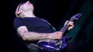 Joe Satriani performs during the G3 concert at Eventim Apollo on April 25, 2018 in London