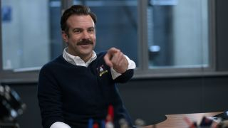 Jason Sudeikis' Ted Lasso pointing at someone in Ted Lasso season 2