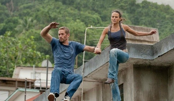 Brian and Mia jumping in Fast Five