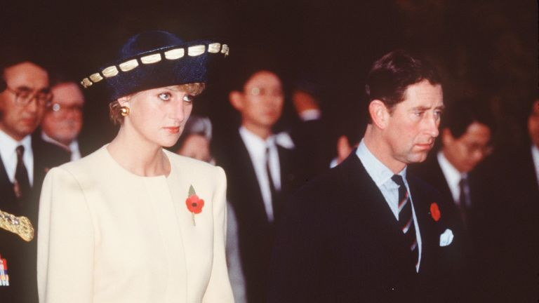 Prince Charles, Prince of Wales and Diana, Princess of Wales, wearing a yellow and navy blue dress and jacket designed by Catherine Walker and a hat by Philip Somerville, visit the National Cemetery