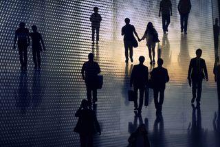 Multiple exposure image of people walking in city