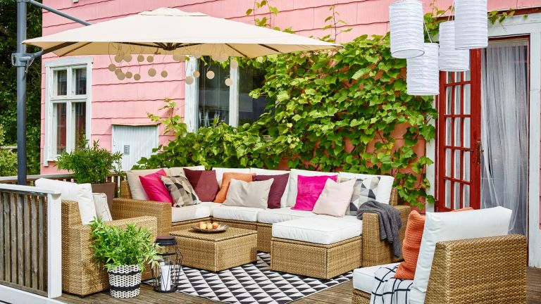 small deck ideas from Ikea with corner sofa and parasol