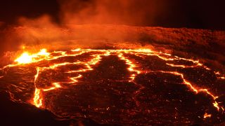 Molten flows glow in a volcano's lava lake.