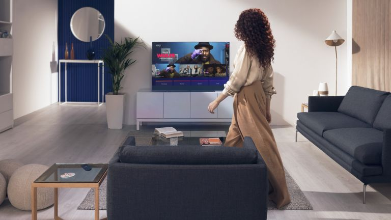 Sky Glass in living room with woman walking past