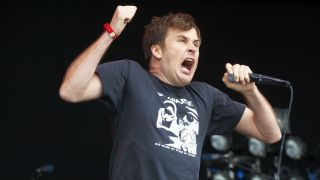 Napalm Death frontman Barney Greenway on stage during Bloodstock Open Air Festival at Catton Hall on August 14, 2011 in Derby.