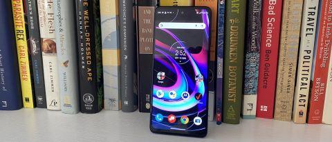 The Motorola Edge 5G UW phone in front of a bookshelf