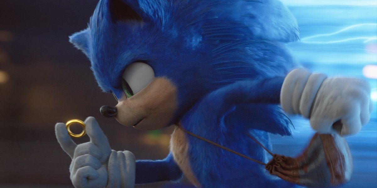 Sonic the Hedgehog running and holding gold ring