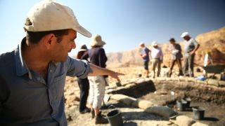 Archaeologist Erez Ben-Yosef points to a trench at Slaves' Hill, a copper smelting camp in Timna Valley where recent excavations revealed a gatehouse.