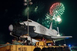 Fireworks celebrate the June 2012 arrival of Houston's full-size space shuttle mockup, which Space Center Houston's contest will now name.