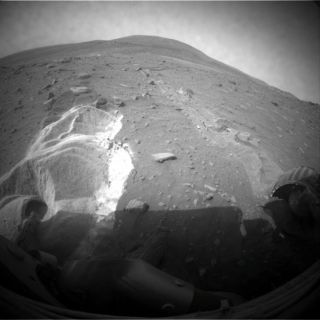 NASA's Mars Rover Spirit's wheels slip as the rover attempts to extricate itself from a patch of soft martian soil