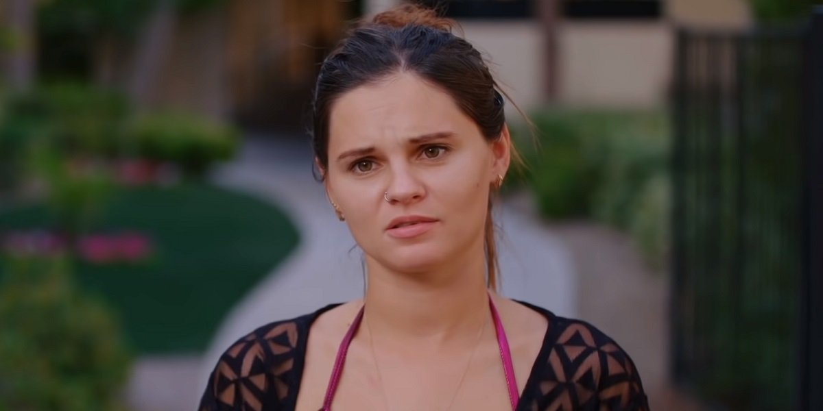 Julia looking concerned at the pool 90 Day Fiance: Happily Ever After?