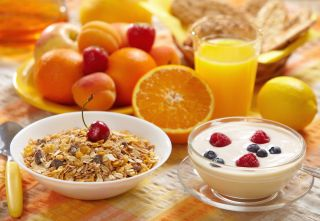 A healthy breakfast of cereal, fruit and yogurt.