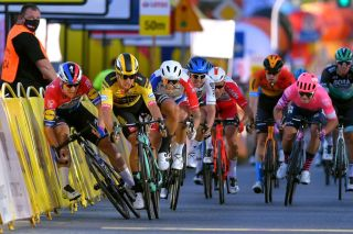 Jumbo-Visma's Dylan Groenewegen (in yellow) was handed a nine-month ban by the UCI for having caused the crash at the 2020 Tour de Pologne that left Dutch road race champion Fabio Jakobsen (Deceuninck-QuickStep) fighting for his life