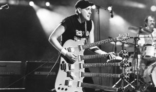 Rick Nielsen performs with Cheap Trick