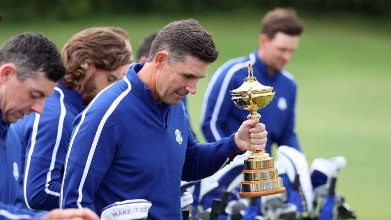 Captain Padraig Harrington of Ireland and team Europe holds the Ryder Cup