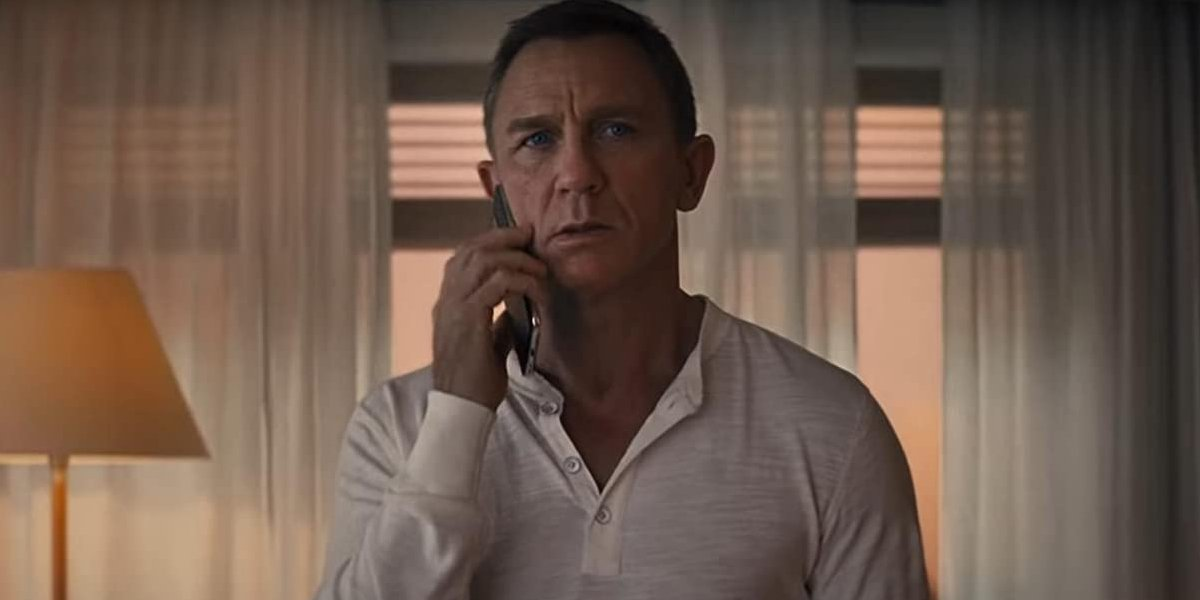 No Time To Die James Bond looking rather concerned over a phone call
