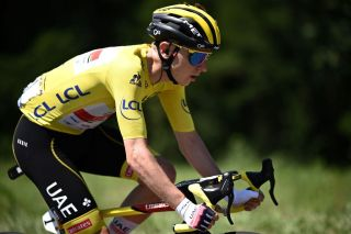 Team UAE Emirates Tadej Pogacar of Slovenia wearing the overall leaders yellow jersey rides in the pack during the 19th stage of the 108th edition of the Tour de France cycling race 207 km between Mourenx and Libourne on July 16 2021 Photo by AnneChristine POUJOULAT AFP Photo by ANNECHRISTINE POUJOULATAFP via Getty Images