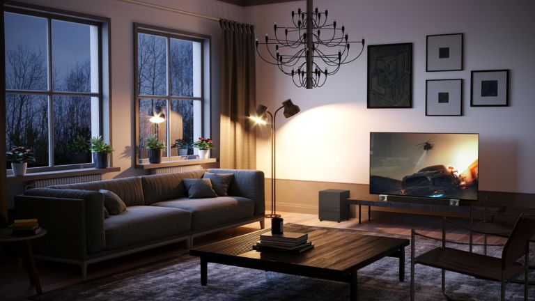 How to make it look like you're home when you're not Modern living room designed with a TV and Klipsch soundbar and atmospheric lighting