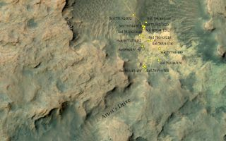 "This area at the base of Mars' Mount Sharp includes a pale outcrop called ""Pahrump Hills,"" which NASA's Curiosity rover investigated from September 2014 to March 2015, and a route toward higher layers of the mountain called ""Artist's Drive."""