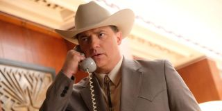 Brendan Fraser takes a phone call looking rather upset in Trust.