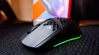 SteelSeries Aerox 3 Wireless gaming mouse at various angles on a black mesh background