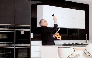 a surveyor conducting a building survey in a kitchen