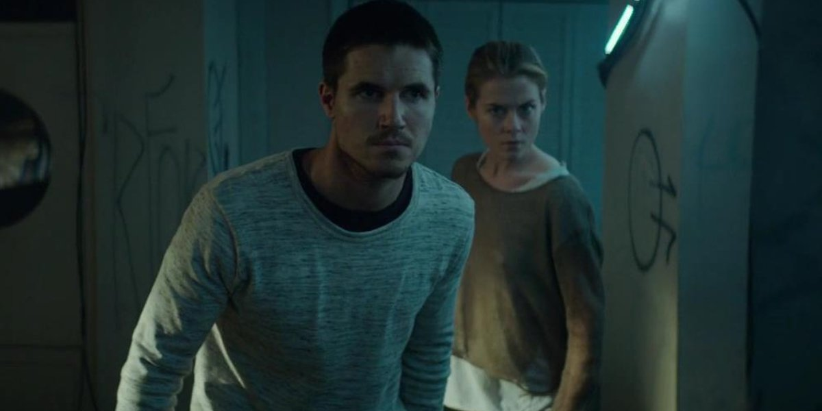 Robbie Amell and Rachael Taylor in ARQ