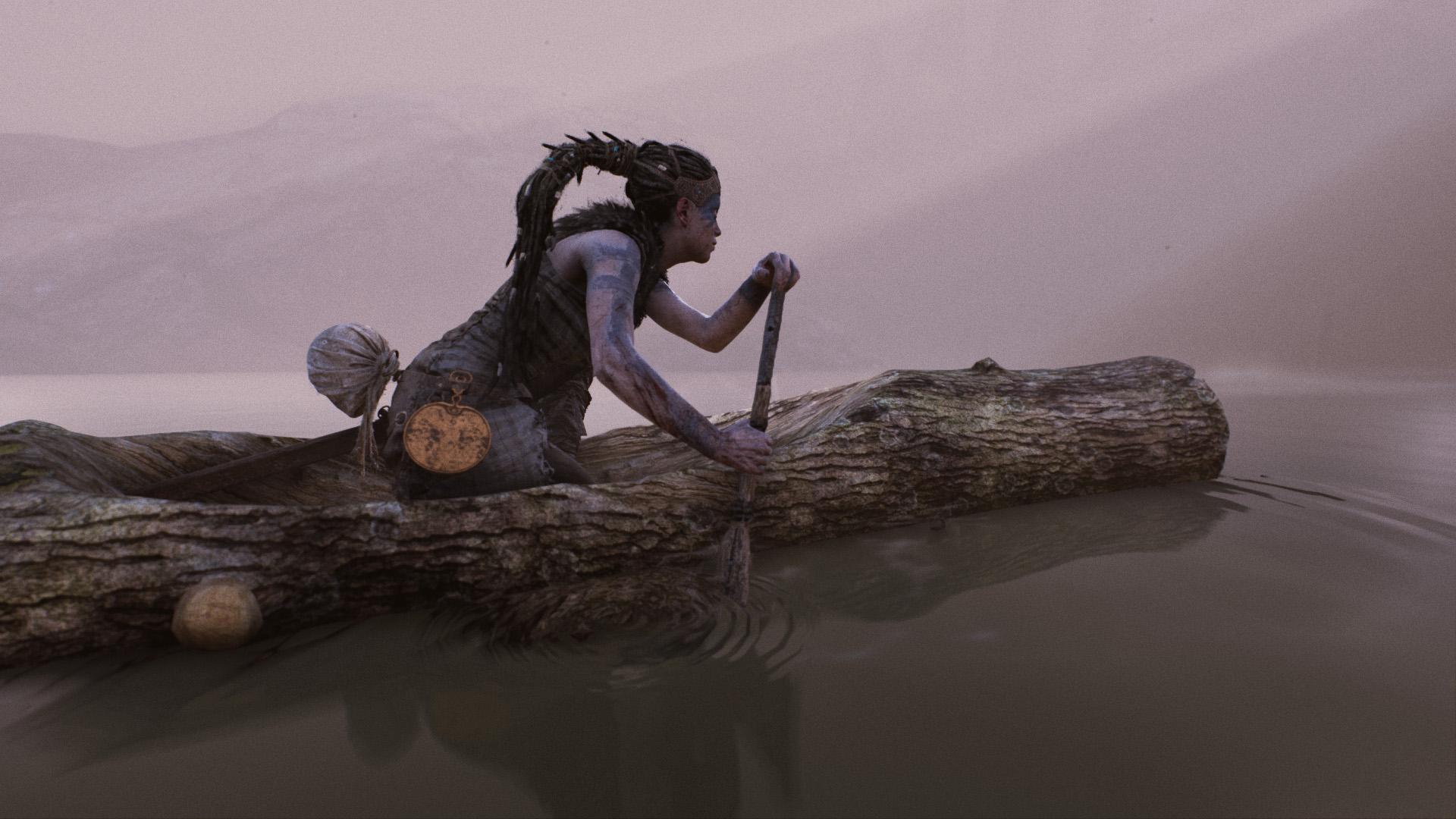 Woman paddling a log through water