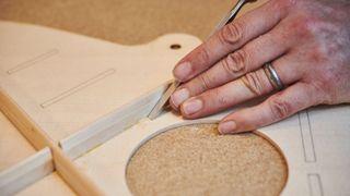 Guitar luthier adjusting bracing
