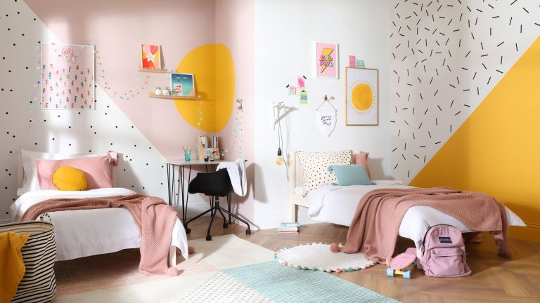 girls' bedroom with yellow and pink walls