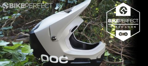 POC Coron Air SPIN full-face helmet in profile placed on a wooden stump