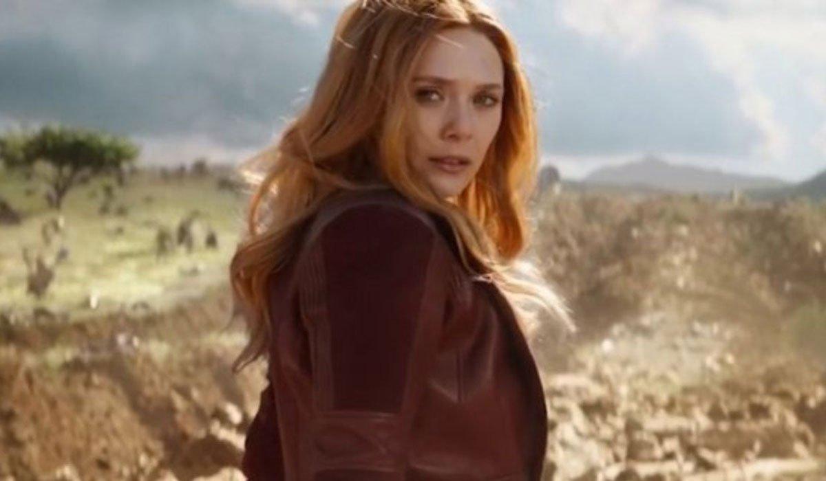 Elizabeth Olsen as Wanda, looking over her shoulder intently.