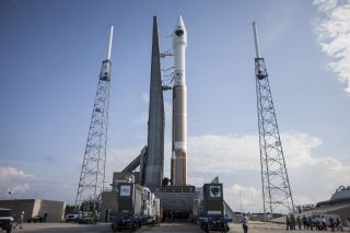 A United Launch Alliance Atlas 5 rocket rolls out to the launch pad carrying the U.S. Air Force's GPS 2F-7 navigation satellite. The mission will launch Aug. 1, 2014 from Cape Canaveral Air Force Station in Florida.