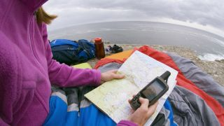 Woman using a gps device for hiking