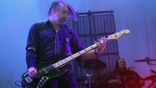 Paul D'Amour playing bass live on stage