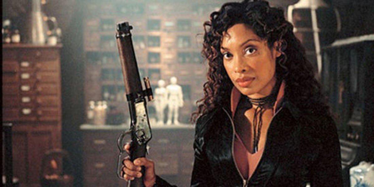 Gina Torres with a gun